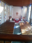 Five Previous Wounds Catholic Church, London NW10, UK: interior facing east. from the gallery