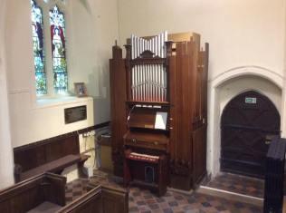 A 'St Cecilia' organ by Henry Jones in St Mary's, Cunningham, Essex {© Dartll East, 2016)