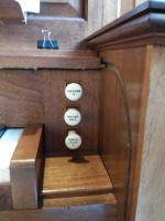 The Nicholson pipe organ in St Joseph's Church, Lamb's Buildings, London EC1: stop jamb, right