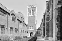St Mary-of-Eton church (1890), London E9, bell-tower gate and courtyard flanked by church (r) and hall (l), c.1950