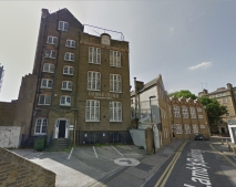 Lamb's Buildings, London EC1: St Joseph's School (1901), and late eighteenth-century building at the junction with Errol Street. (Google Streetview)
