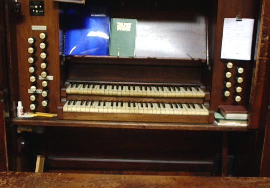 The console of the 1889 Alfred Monk pipe-organ in St Thomas the Apostle parish church, London N4, c.2009