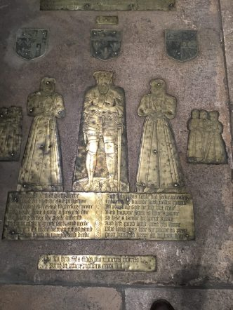 St Mary's Church, Willesden. Memorial brass to Edmund Roberts(1585) The shields: left, the arms of the Roberts/Patenson families; centre, the arms of the Roberts family; right, the arms of the Roberts/Welles. Edmund's first wife (right) Fraunces Welles. Behind her are her two sons and four daughters. Edmund's second wife (left) is Fayth Patenson. Standing behind are her two sons and one daughter.©Andrew Pink 2017