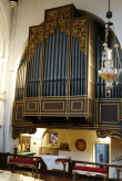 Organ case by J. H. Gibbons in the church of St Augustine of Canterbury, Highgate, London N6. (Source: London Churches in Photographs)