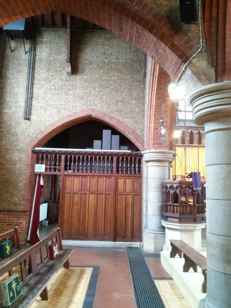 St Andrew's church Earlsfield, London UK, north aisle screen, as in 2017.