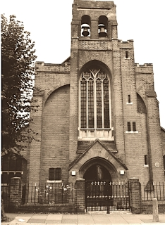 The west fron (1903) of St Aldhelm's church, London N18, by W. D. Caröe.