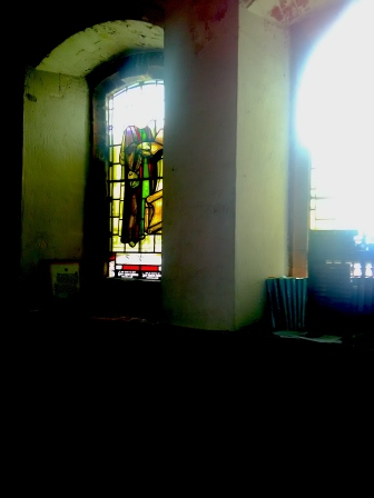 Stained glass (1947-8) by W. P Starmer (1871–1961) in the south aisle of St Aldhelm's church, London N18, in 2017.