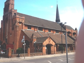 The south side (1903) of St Aldhelm's church, London N18, by W. D. Caröe.