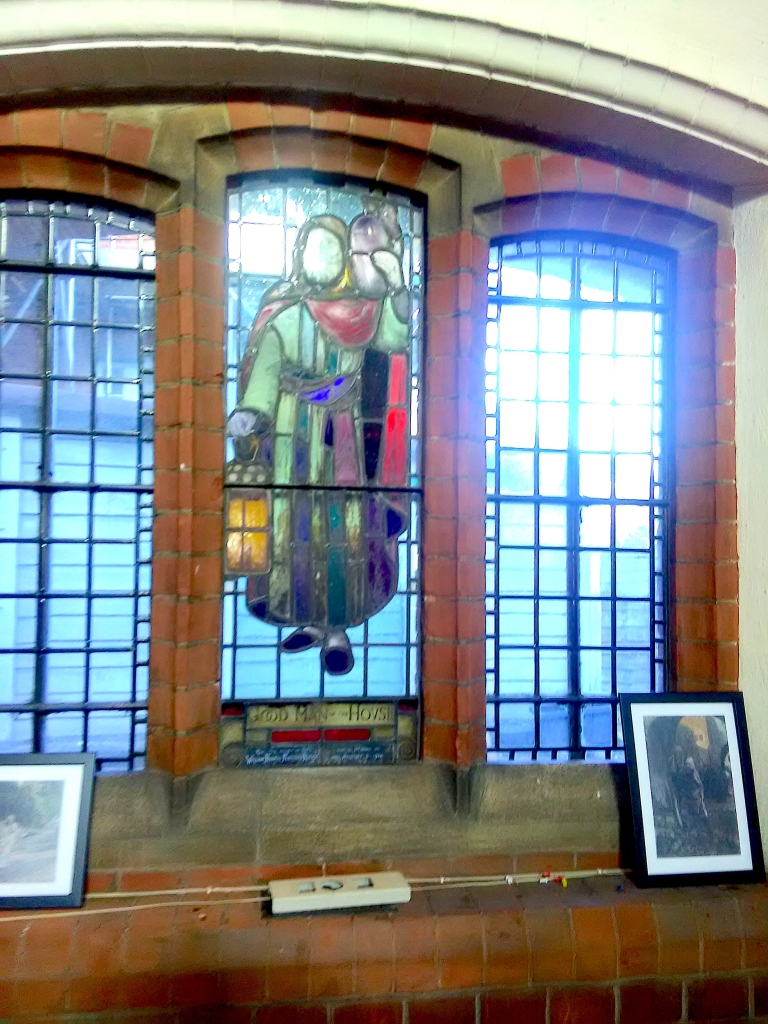 Stained glass (1947-8) by W. P Starmer (1871–1961) in the north aisle of St Aldhelm's church, London N18, in 2017.