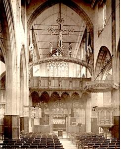 St Agnes Kennington, London, UK. The nave looking towards the chancel screen (1898). [Source. RIBA 58067]
