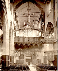 St Agnes Kennington, London, UK. The nave looking towards the chancel screen (1898). [Source. RIBA 58067]