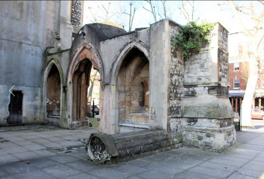 St Mary Newington, London. Looking from the courtyard through the remnant of old west wall towards Kennington Park Road c.2000
